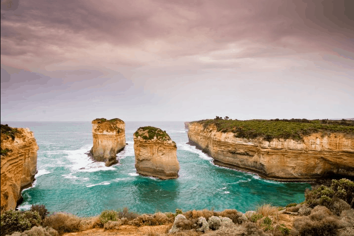 Limestone stacks sticking out of the ocean.