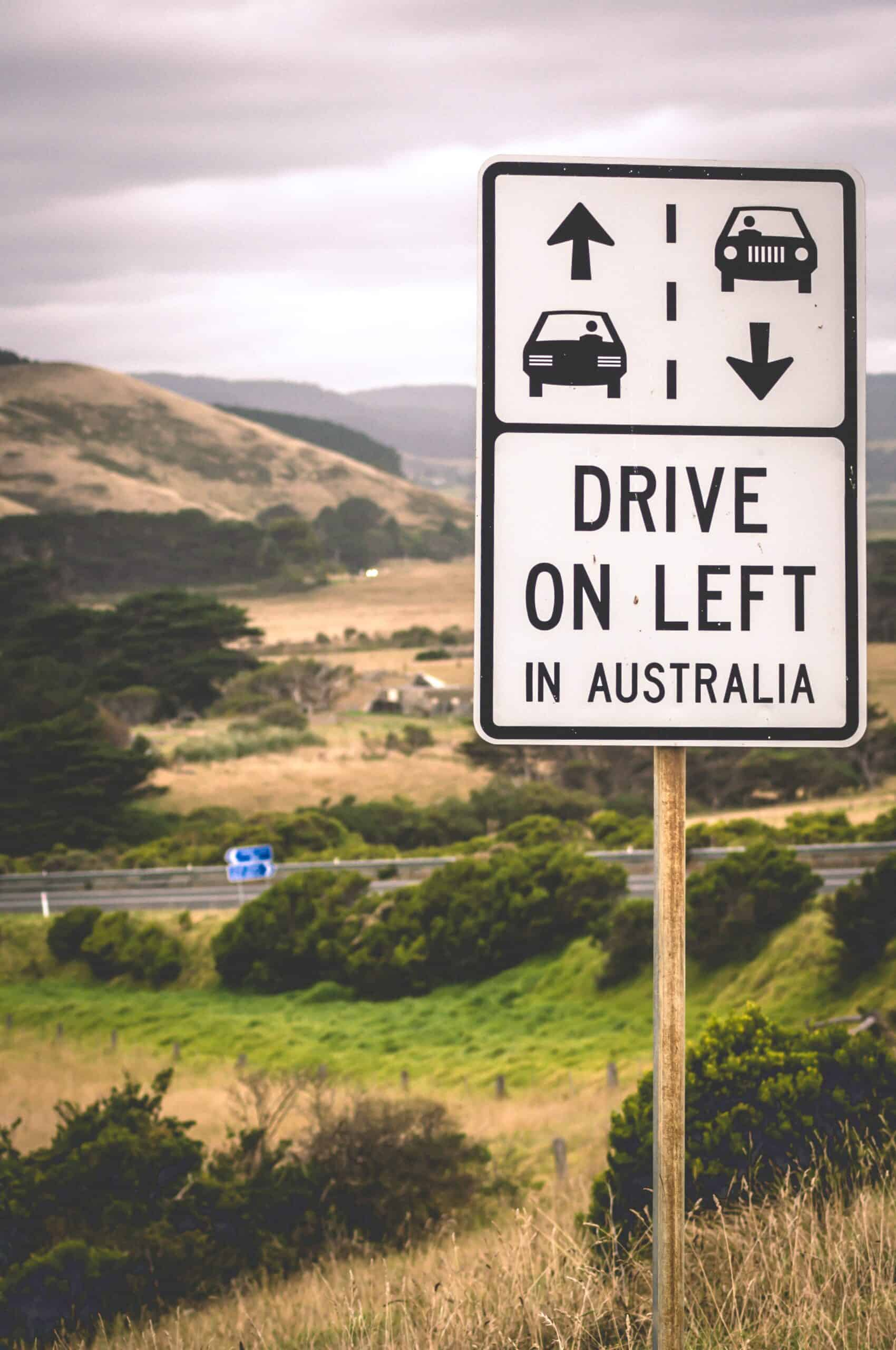 A road sign sowing to Drive on the left in Australia.