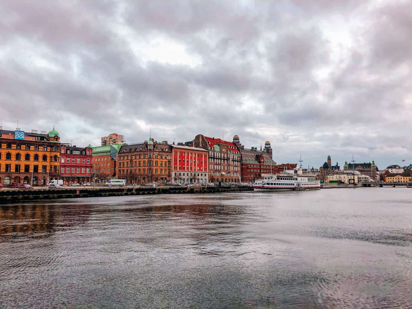 colourful buildings lining a harbour