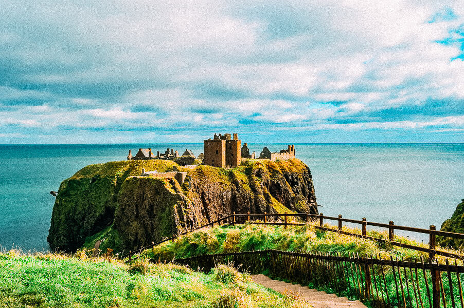 An old castle ruin on a cliff by the ocean