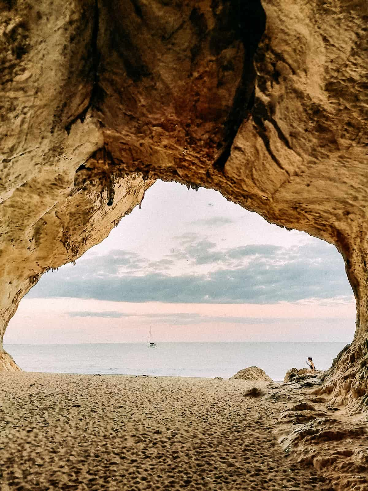 A cove looking out on the ocean with sand under neither