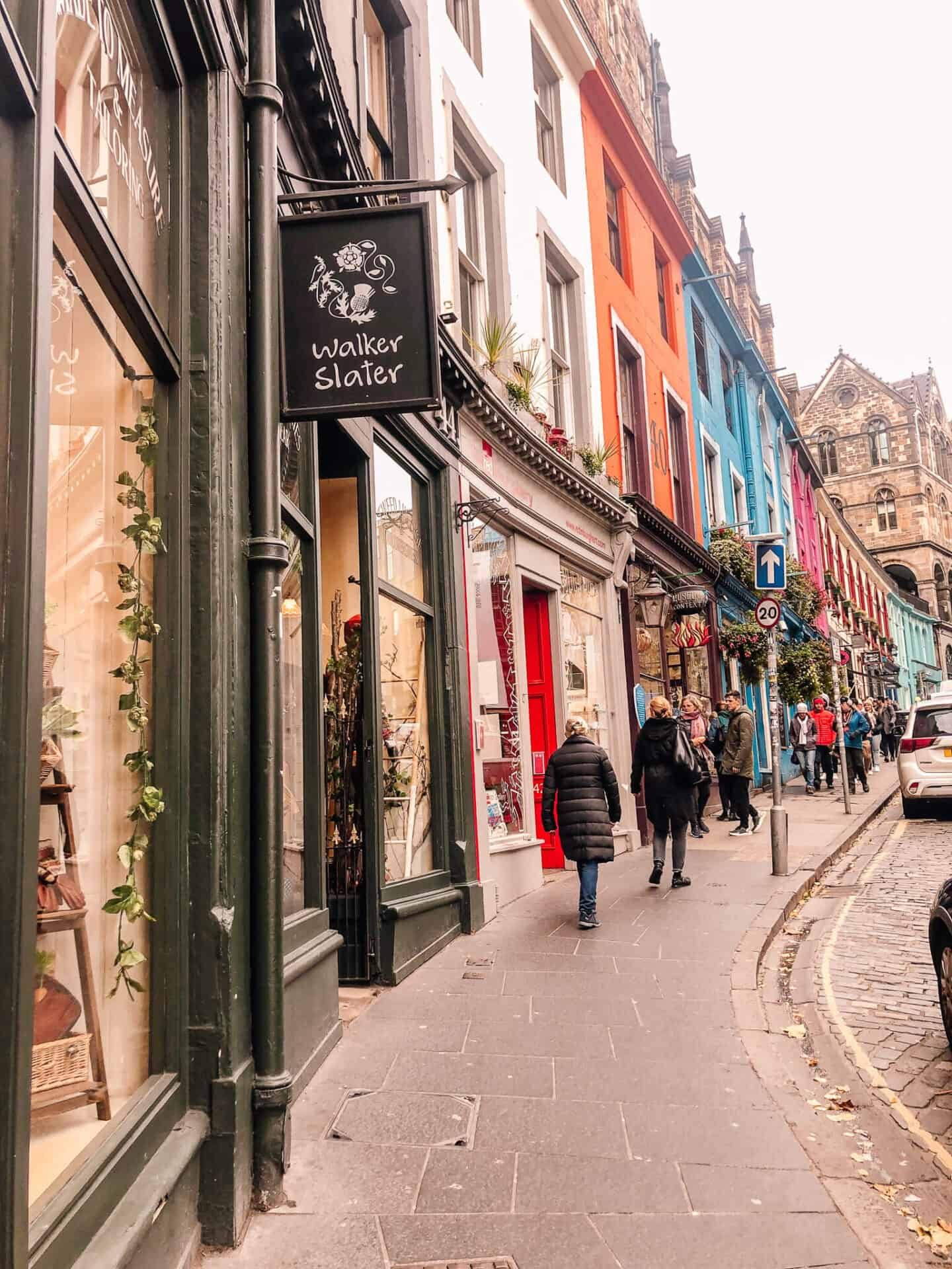 Uphill street with colourful shops and buildings in Edinburgh