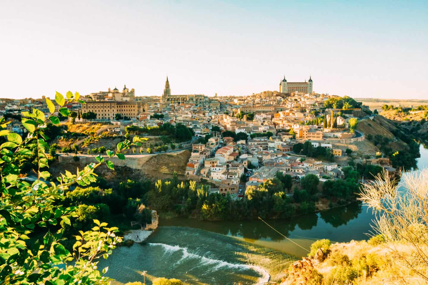View of an old city surrounded by a river