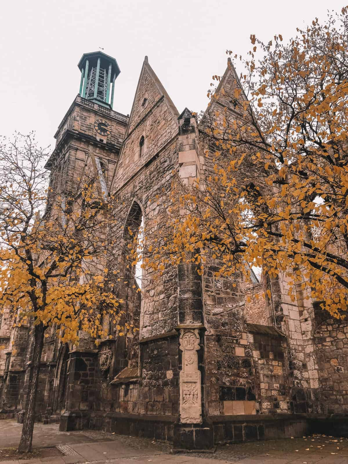 An old destroyed church with autumn leaves