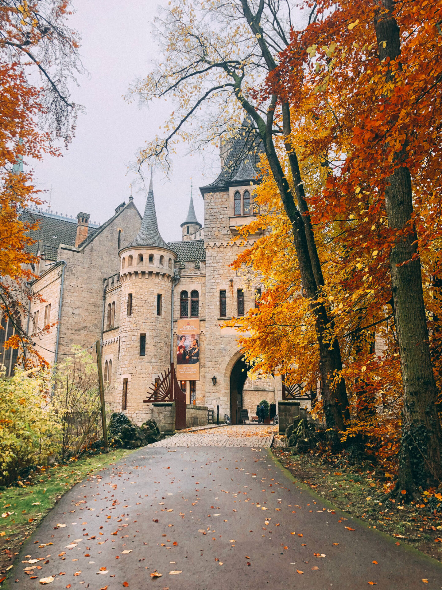 Castle surrounded by autumn leaves