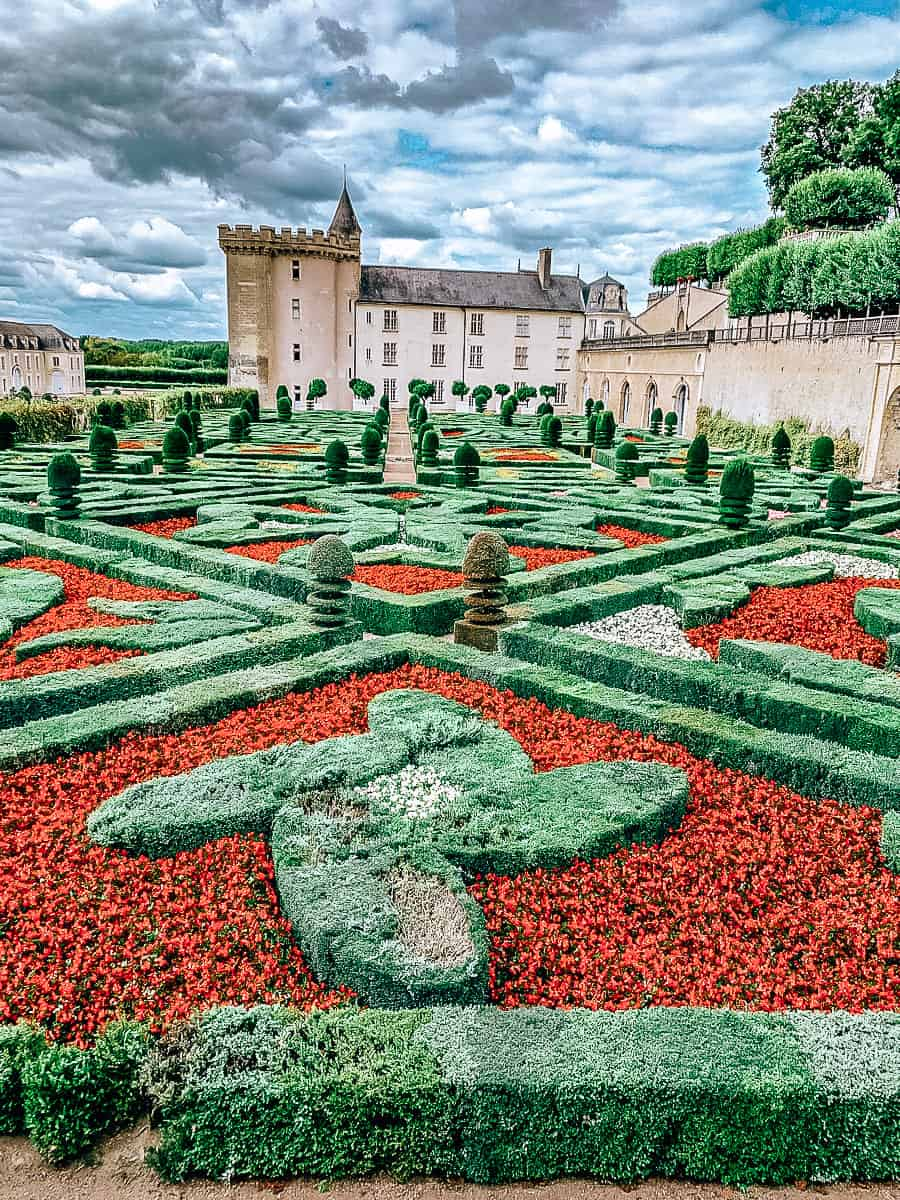 Green and red garden in front of castle
