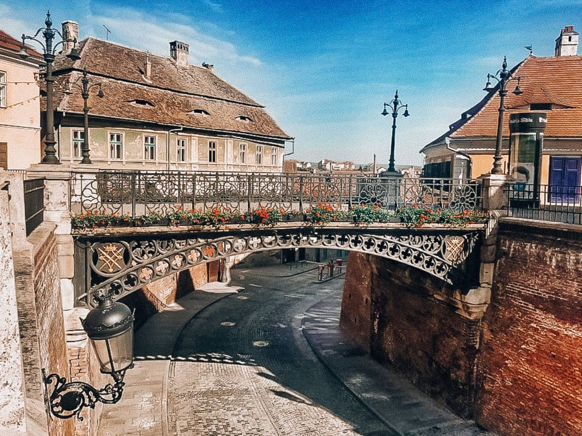 A bridge over a old cobblestone street