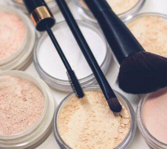 Make up brushes sitting on powder foundation