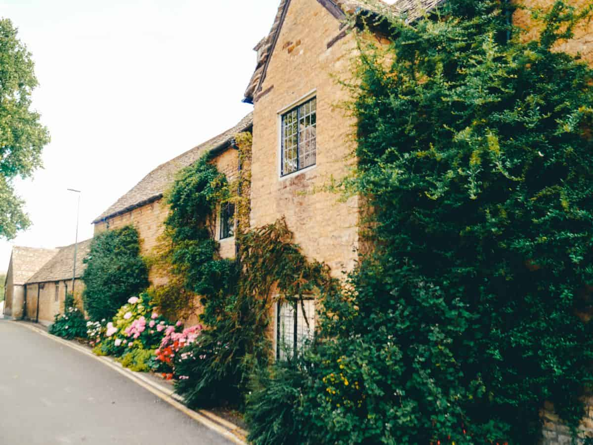 Sandstone cottages covered in greenery