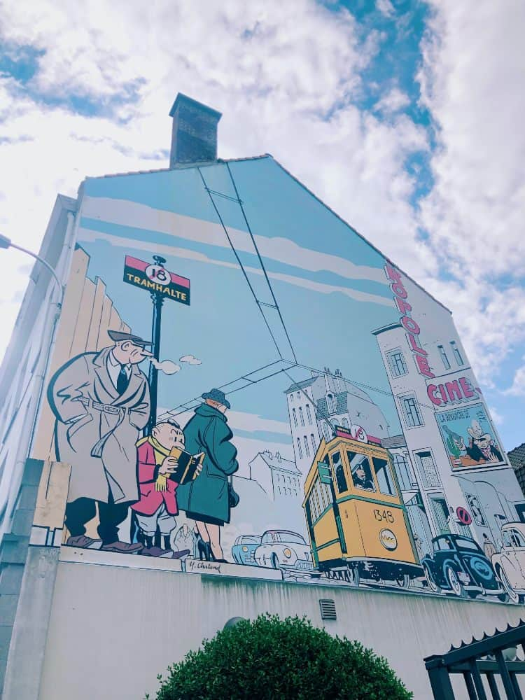 A building with a cartoon mural painted on the side