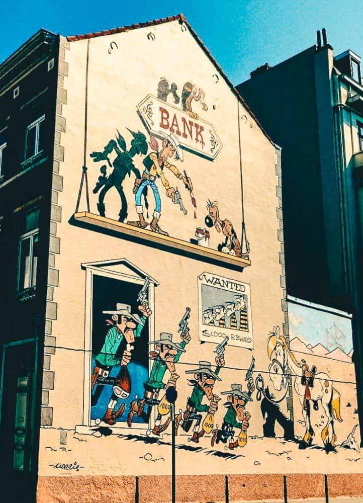 A cartoon mural on the side of a city building