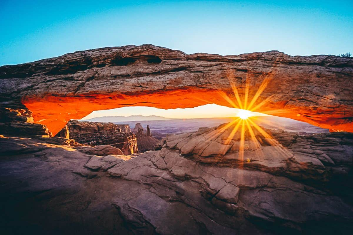 Sun setting under a rock formation