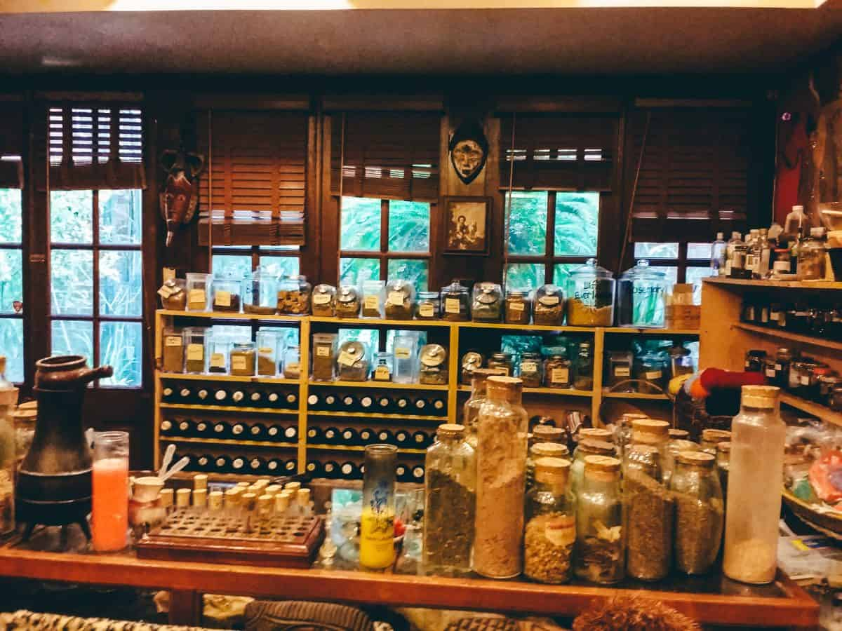 A shop counter filled with jars and vials