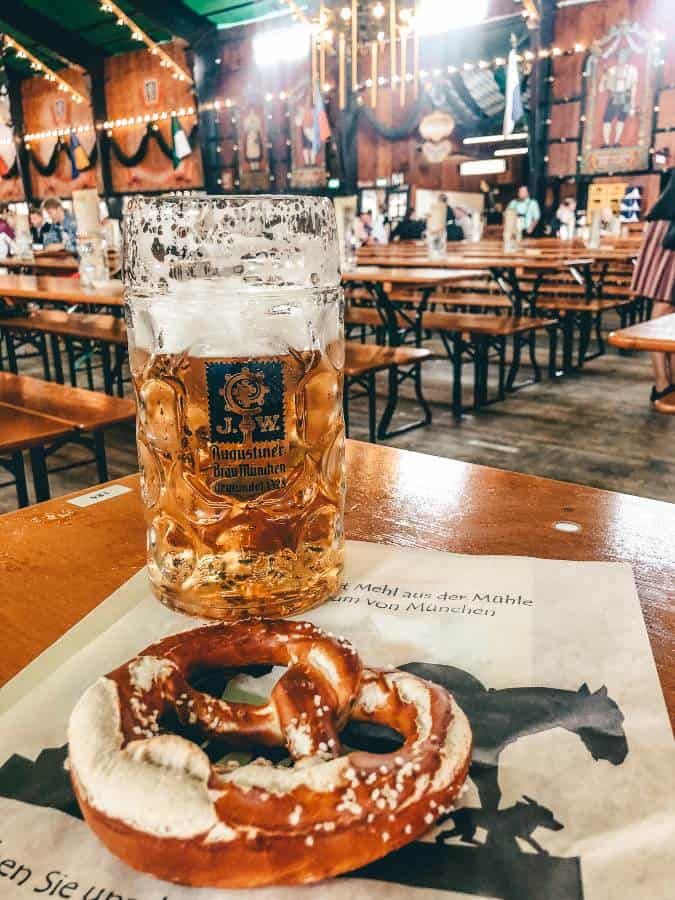 A stein of beer on a table inside a marque