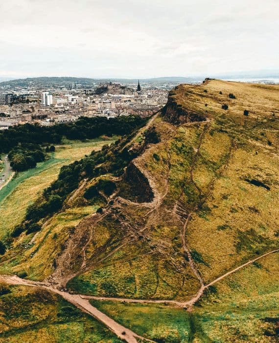A grassy hill looking over Edinburgh City.