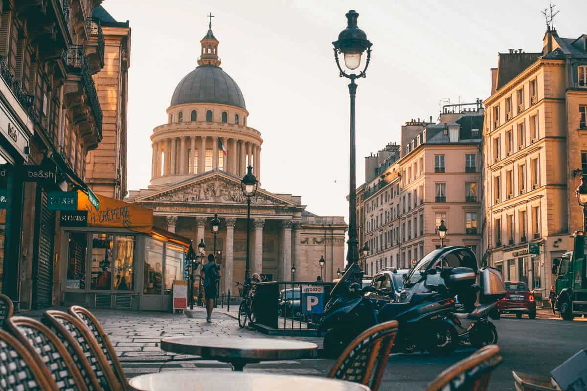 A cafe looking down an old Parisian street onto the pantheon