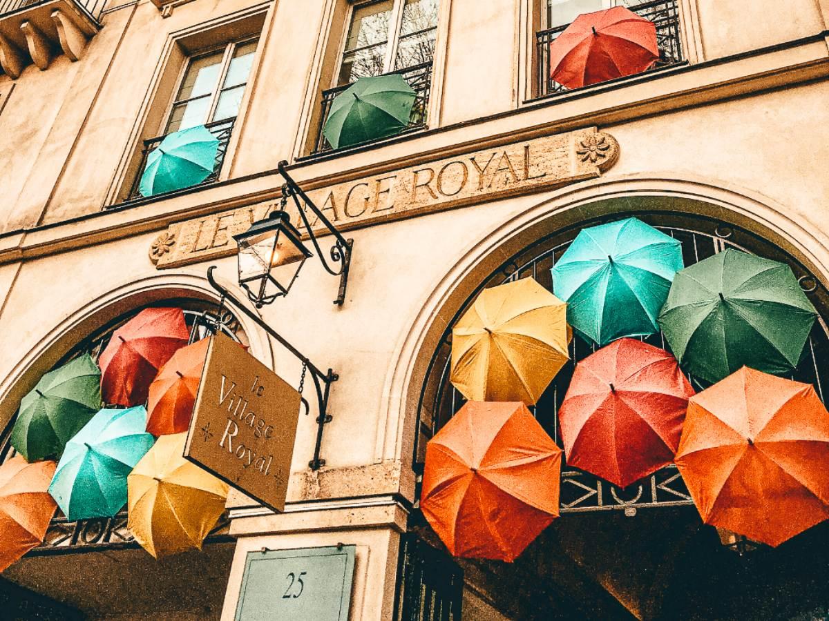 Umbrellas in the arch way at Le Village Royal, Paris