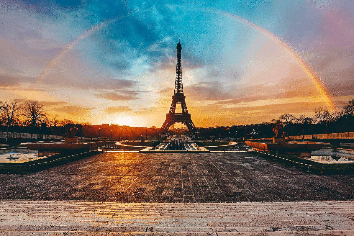 A rainbow over the Eiffel tower at sunset