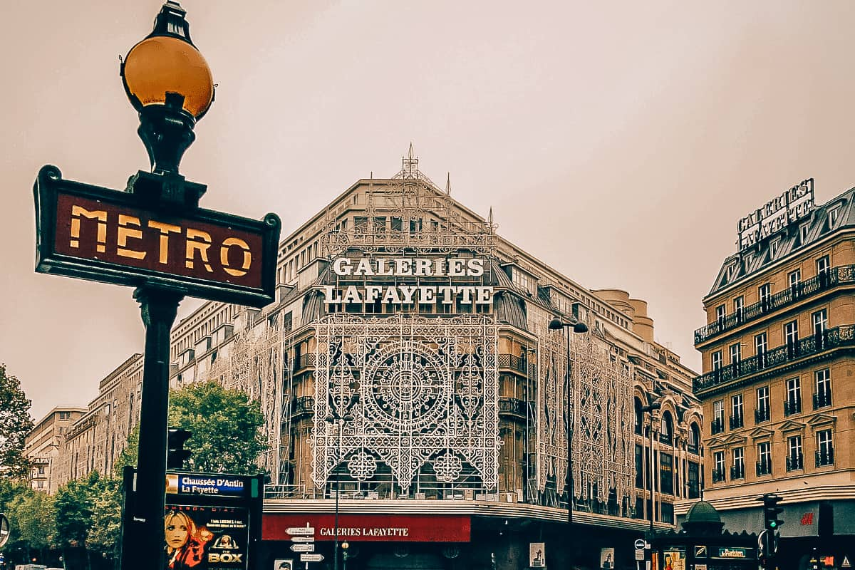 A metro sign outside of Galeries Lafayette in Paris