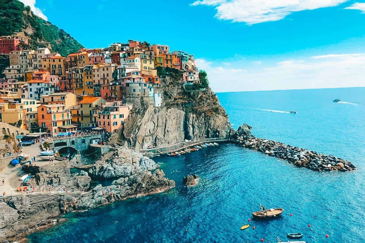 Coloured houses of Cinque Terre sitting on a cliff top overlooking the ocean