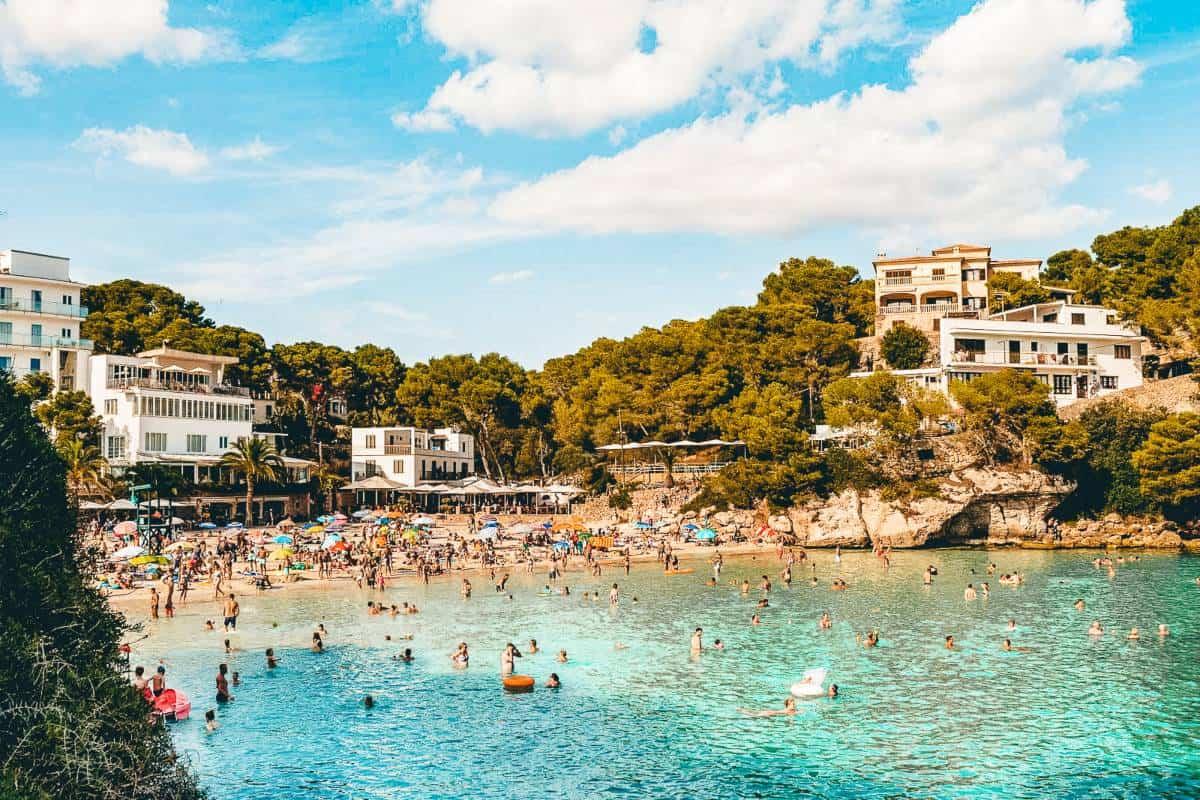 People swimming in the Ocean at Cala Santanyi Mallorca.