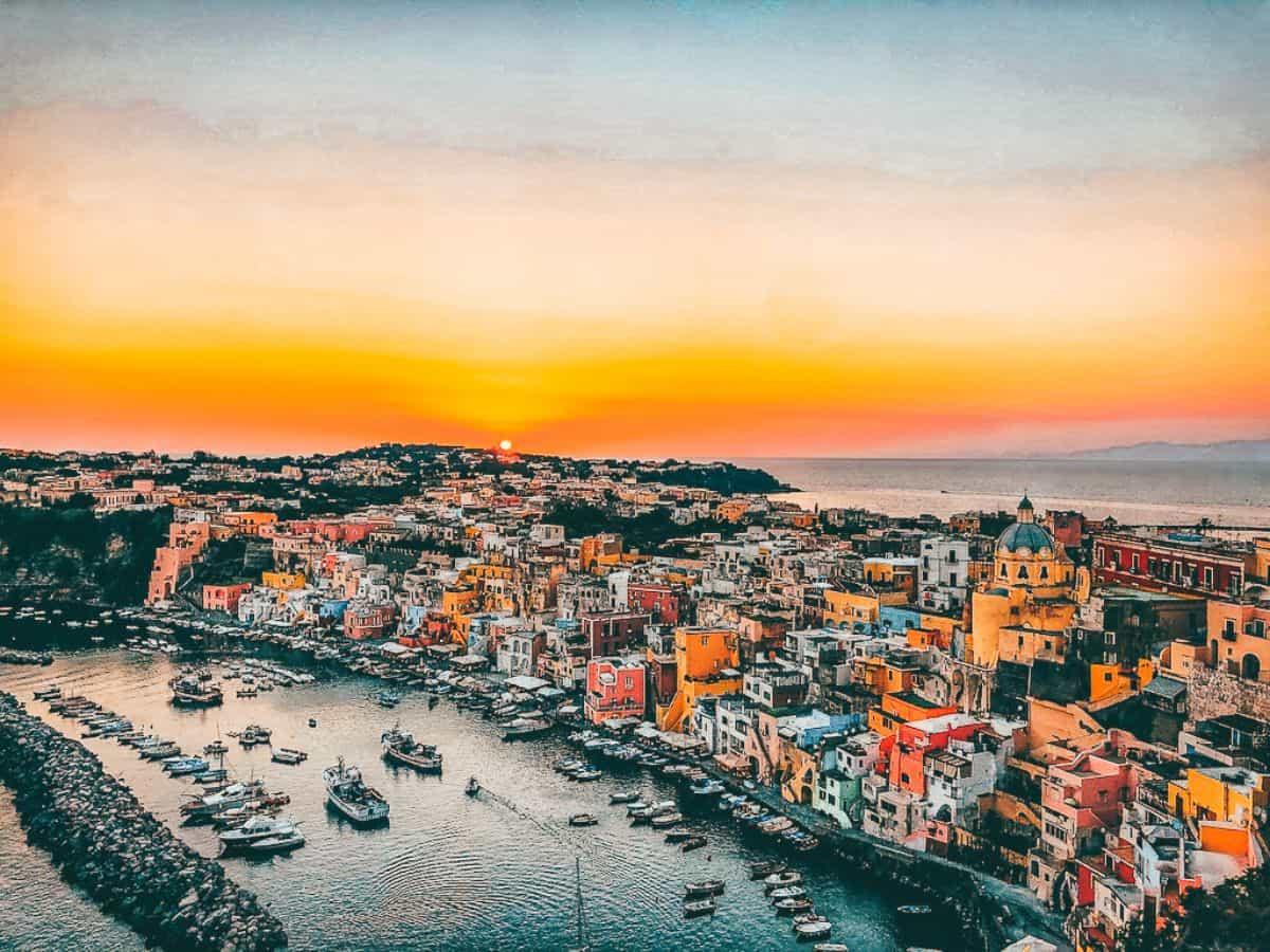 The sun setting over Procida in Italy