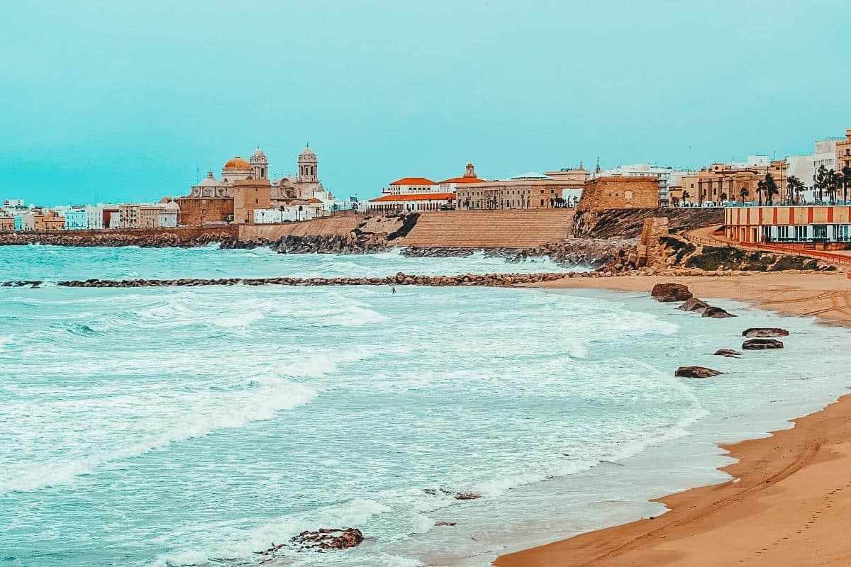 Old Mediterranean buildings lining the beach in Cadiz, Spain