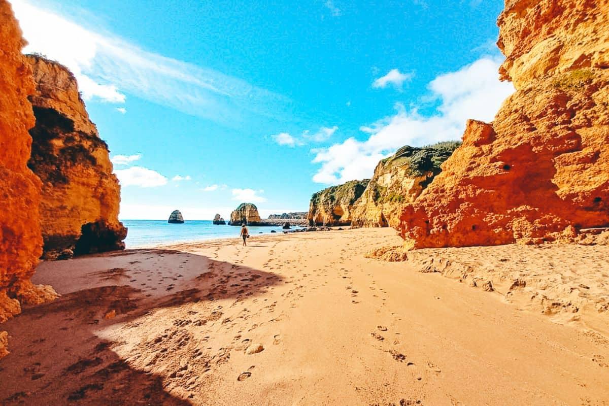 Rocky cliffs on a sandy beach at Lagos Portugal