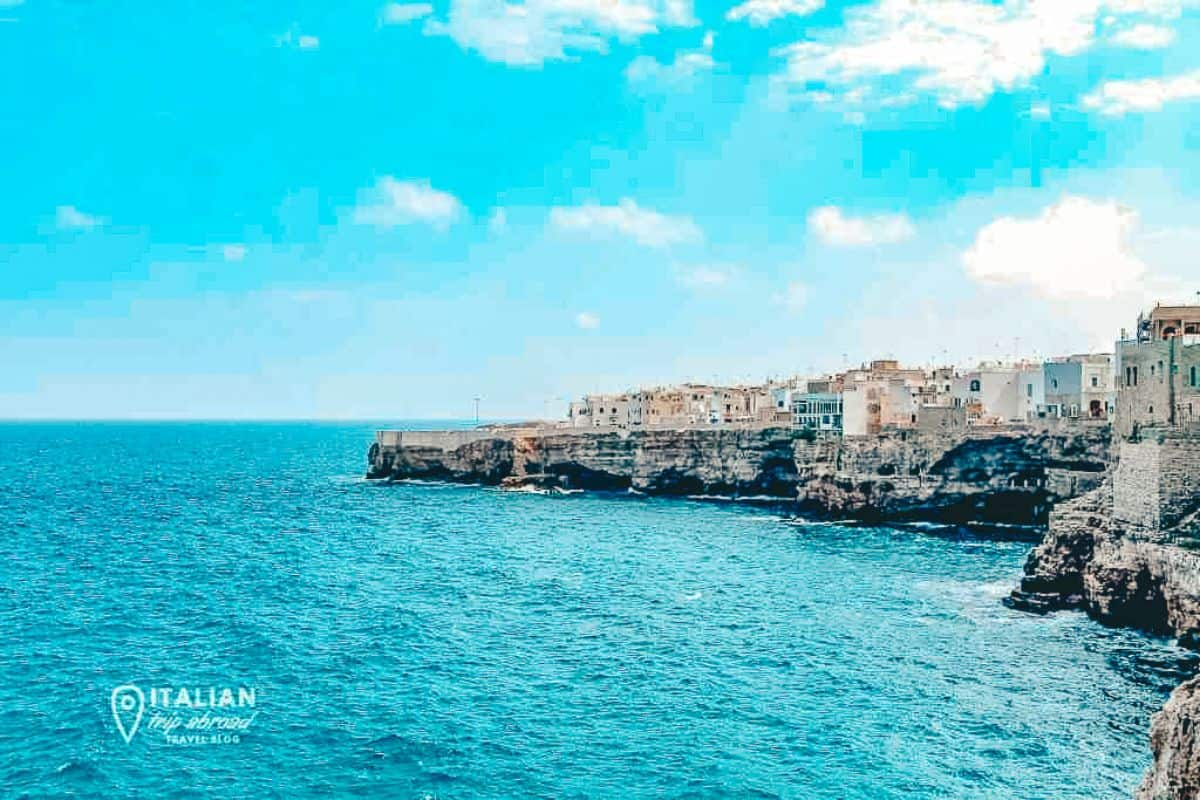 A view of the italian buildings along the coast at Polignano a mare
