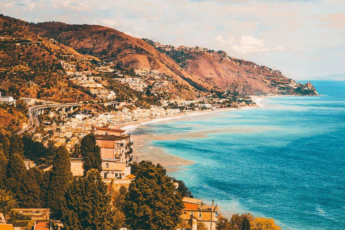 A view over the Italian coast lined with hills at Taormina, Italy