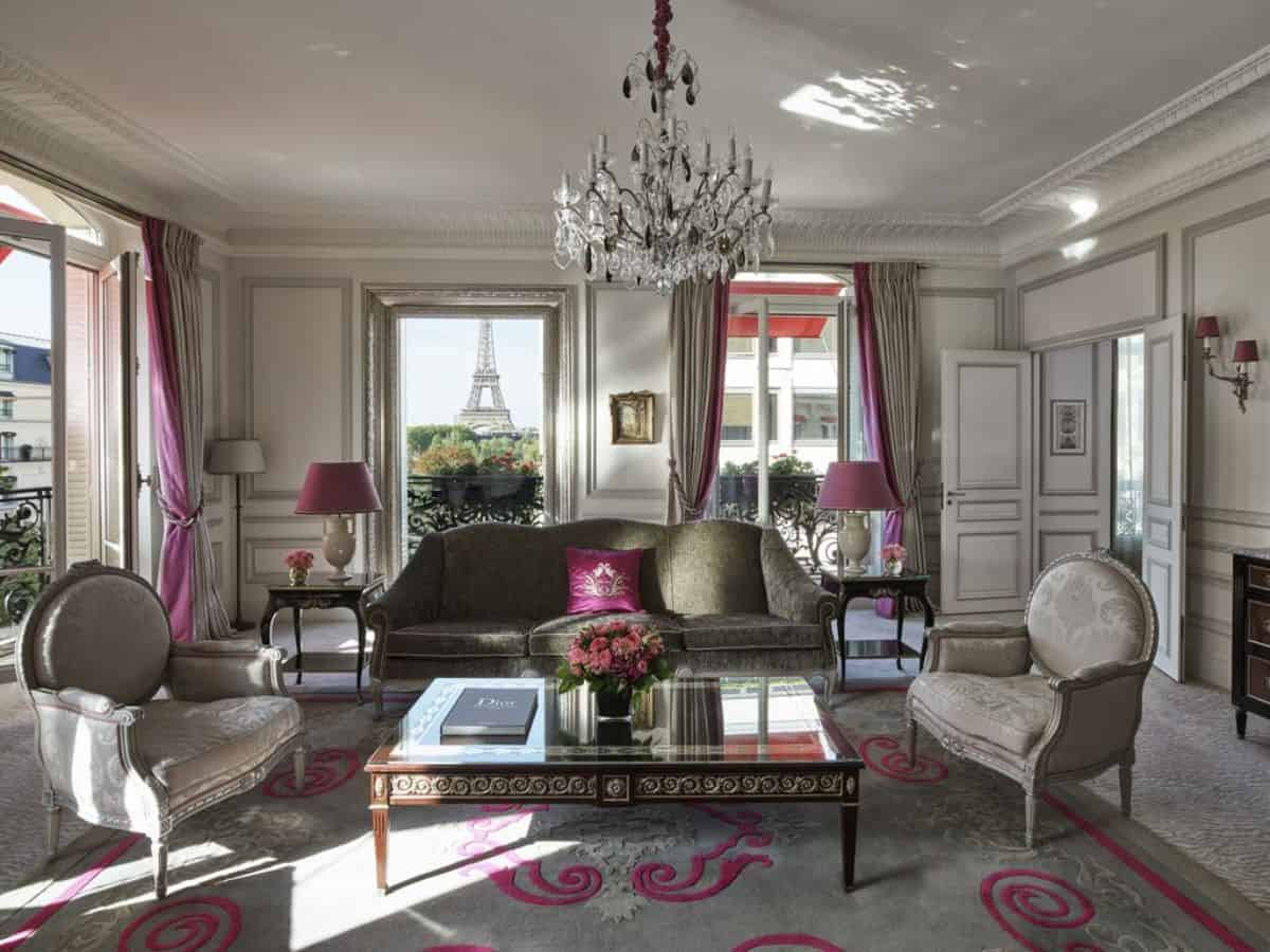 A grand lounge room with a view of the Eiffel tower
