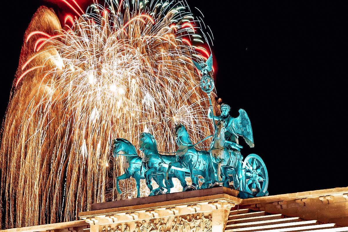 A fireworks display over the top of the Brandenburg Gate