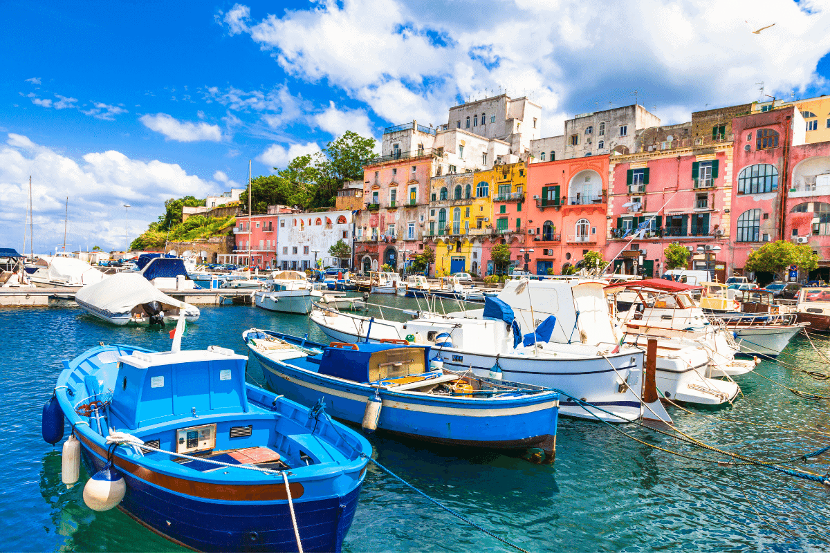 Coloured buildings next to a harbour filled with boats