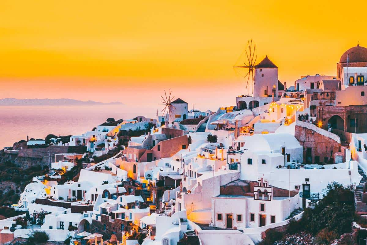 The sunsetting over the white buildings of Mykonos, Greece
