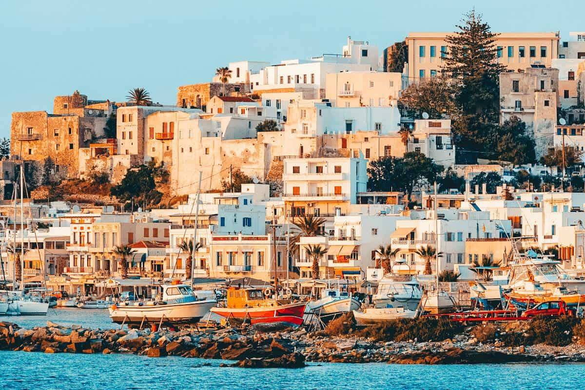 Old Greek Houses and Boats lining the ocean in Naxos