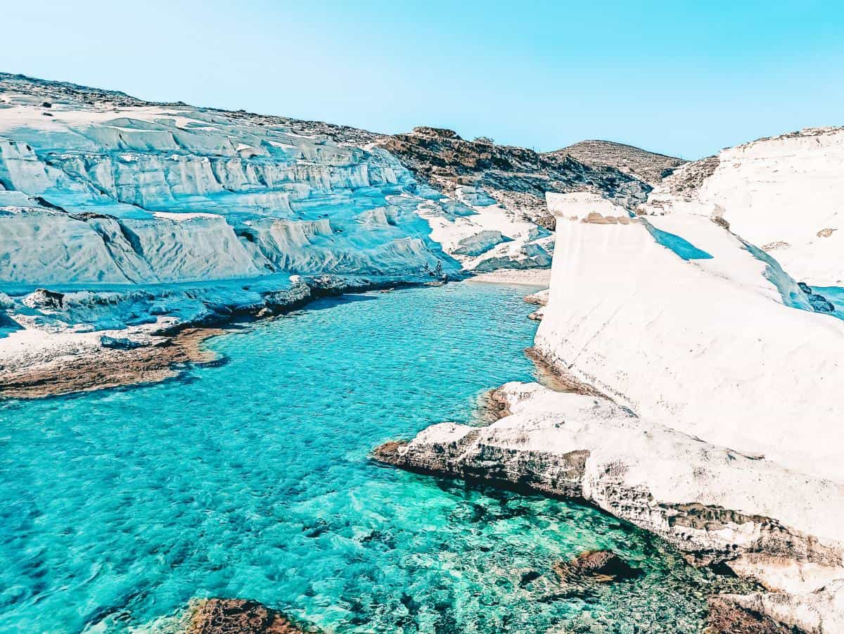 Clear blue water surrounded by white cliffs