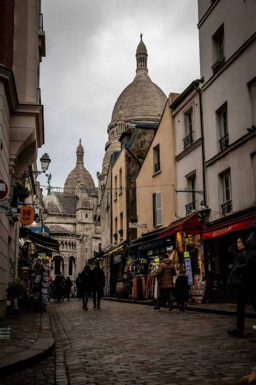 Two people strolling the streets of montmartre