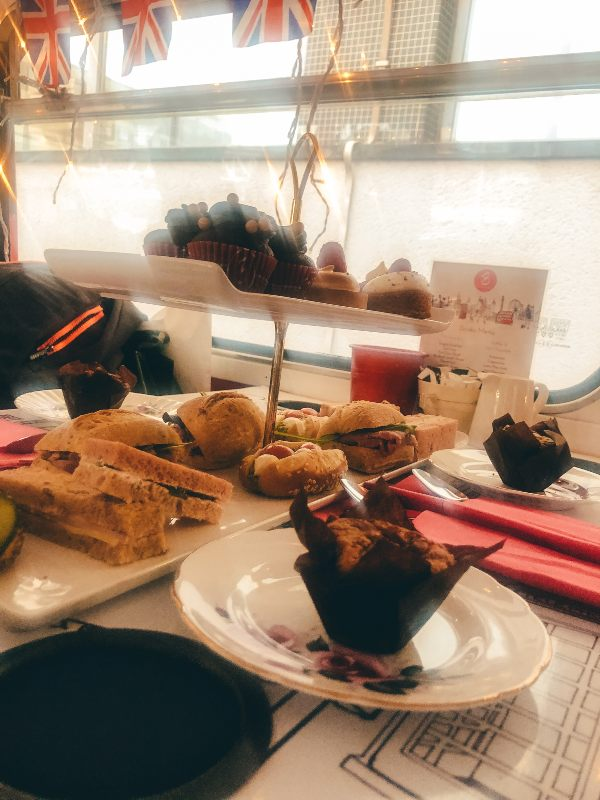 An assortment of cakes and sandwiches on a table