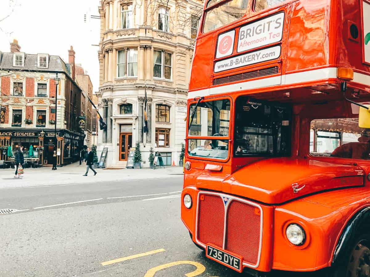 A red double decker bus on the a London street