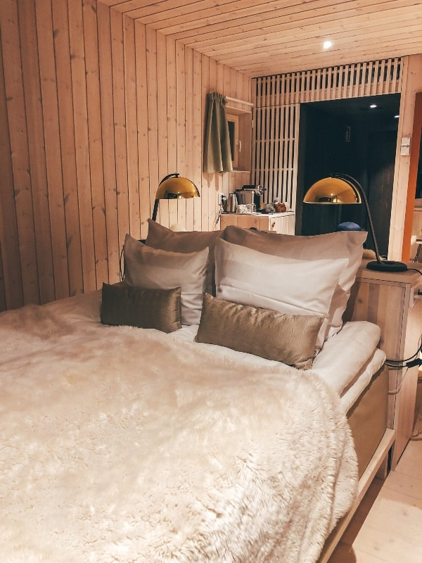 A fluffy bed in a simple finnish hotel room