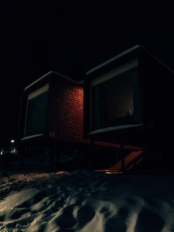 Red Rectangle box room numbered 41 in the dark surrounded by snow
