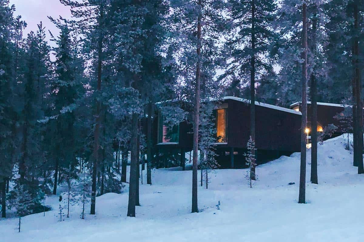 Rectangle box rooms in the arctic forest at the Arctic Treehouse hotel in Rovaniemi