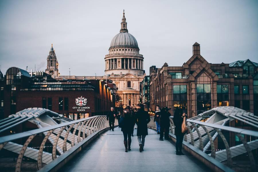 People crossing a bridge in London