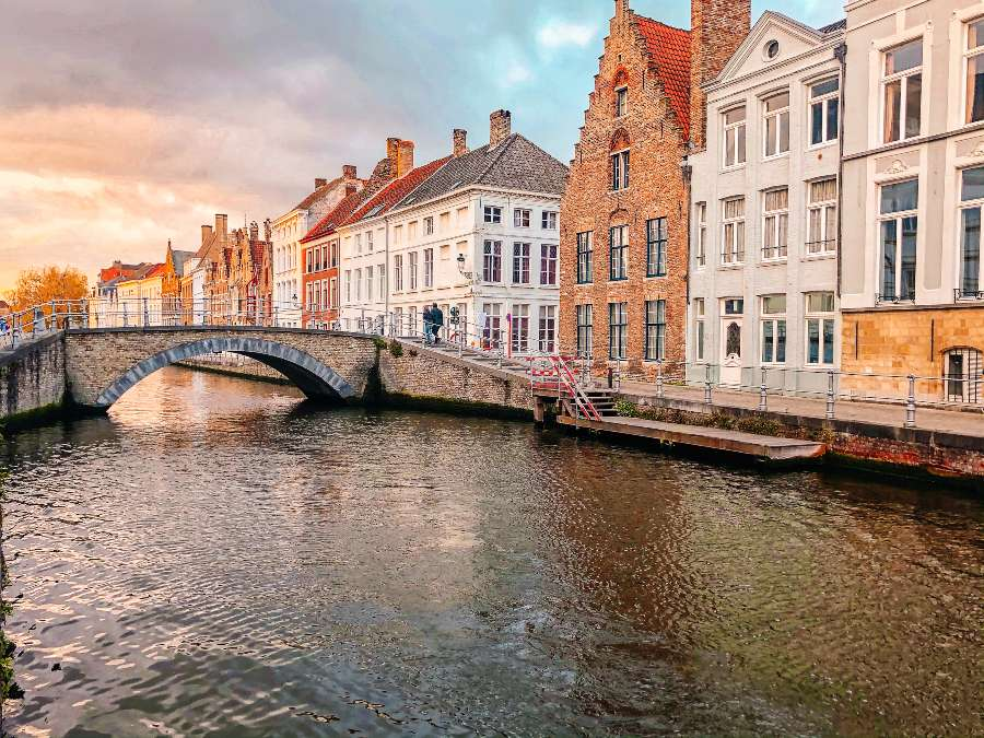 The colourful buildings in Bruges lining the canal in October