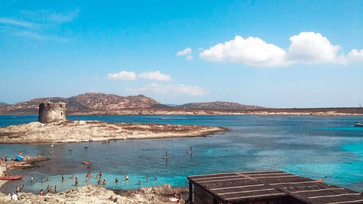 Best Summer Destinations in Europe - Beach looking out in to a very blue ocean with an island in the middle.