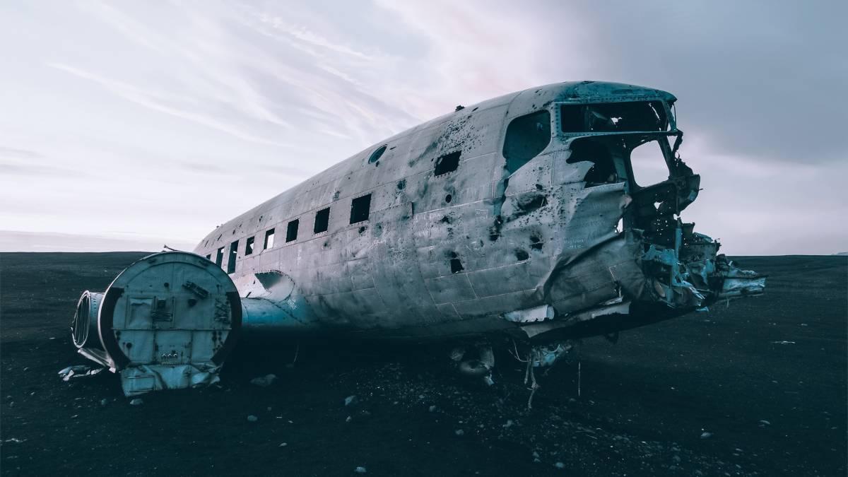 An abandoned plane crash on a black beach Iceland