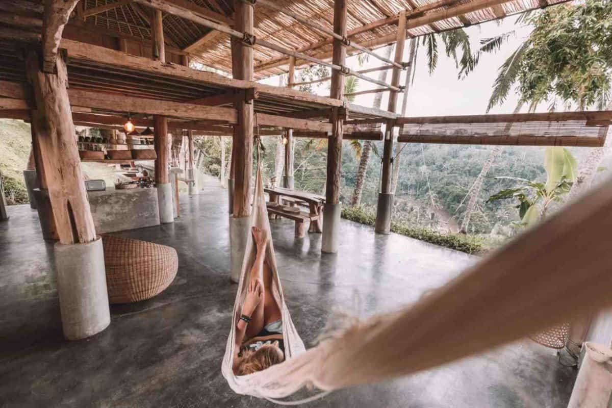 Someone lying in a hammock in an open living area