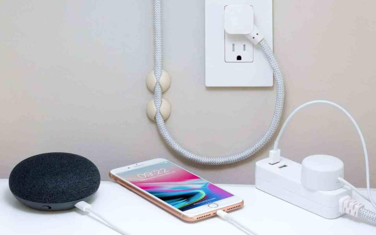 An iphone plugged into a power outlet