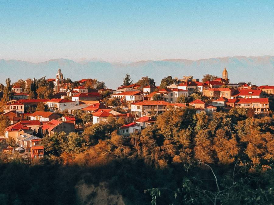 Houses in the mountain with orange roofs