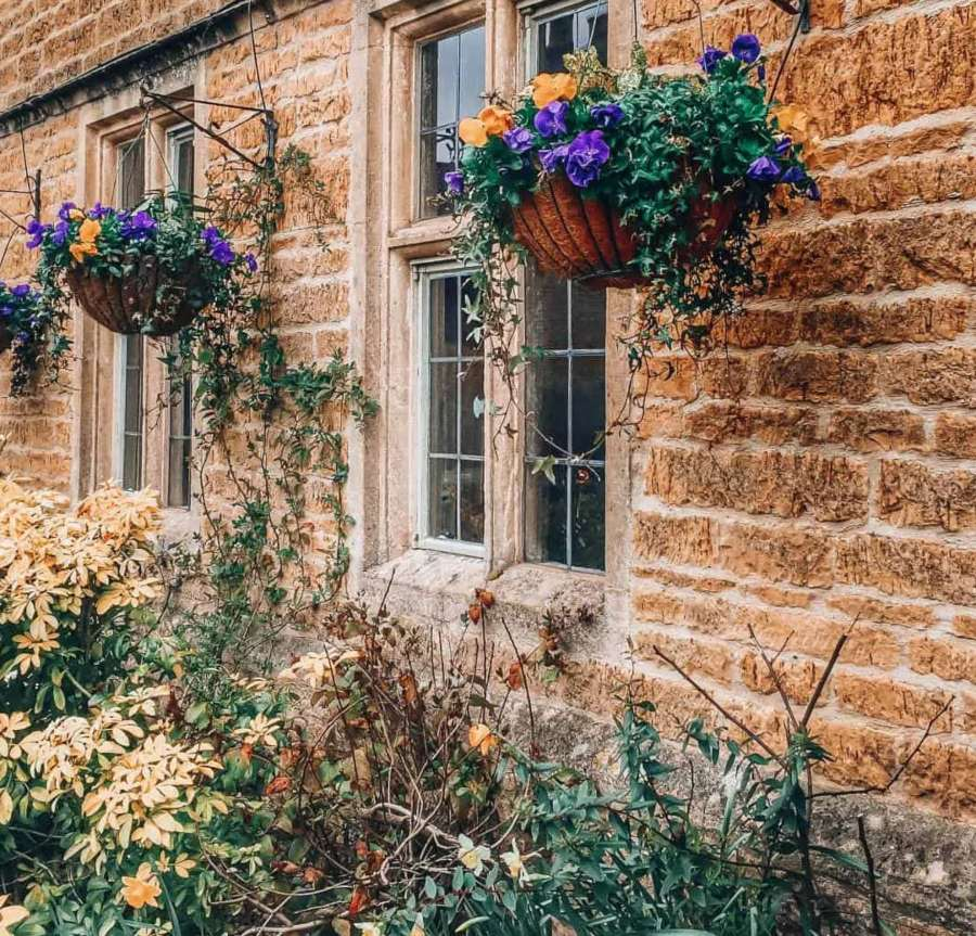 Flowers on a stone cottage
